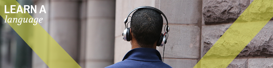 Man Walking Down Street Wearing Headphones